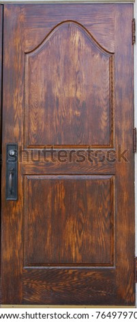 A historic wooden door with handle and lock - stock photo