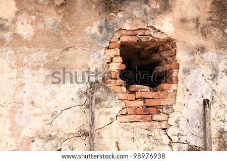 A hole from fired and collasped of temple wall, Thailand - stock photo