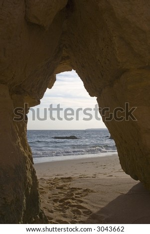 A hole in a rock at the beach in Portugal