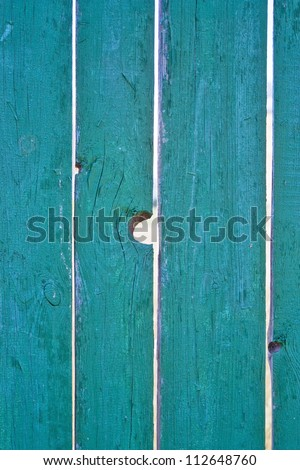 a hole in the fence - stock photo