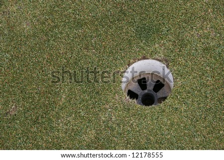 a hole on a golf course - stock photo
