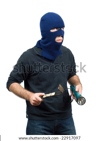 A home burglar isolated against a white background, holding a flashlight and a crowbar - stock photo