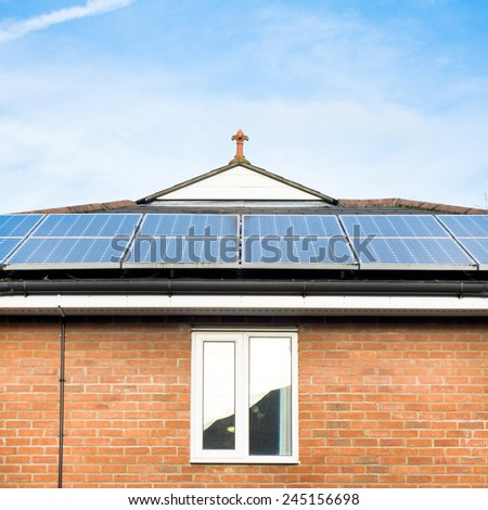 A home in England with solar panels on the roof - stock photo