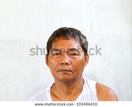 A homeless man begging for work and food. - stock photo