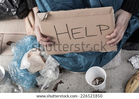 A homeless man on the street asking for money - stock photo
