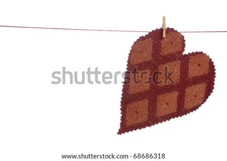A Homemade Material Heart Hanging on a Clothesline with Room for Text - stock photo