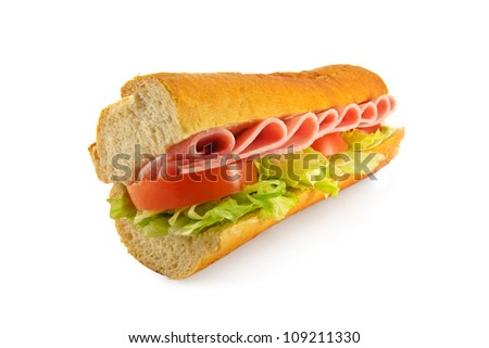A homemade sandwich with one of the most popular fillings ham salad, made with a freshly baked french bread baguette - stock photo