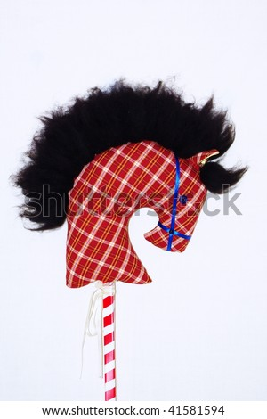 A homemade toy horse's head on a stick - stock photo