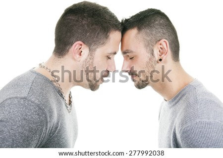 A homosexual couple over a white background on studio - stock photo
