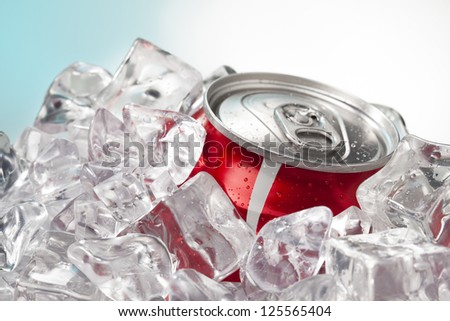 A horizontal image of a red soda in can surround by ice block - stock photo
