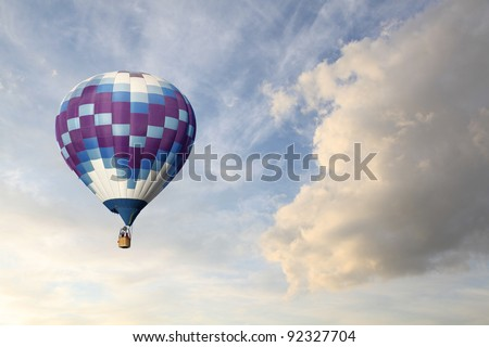 A Hot Air Balloon in a Cloudy Sky - stock photo