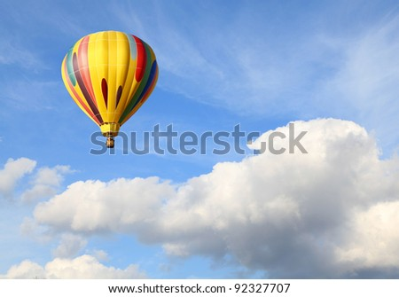 A Hot Air Balloon in a Cloudy Sky