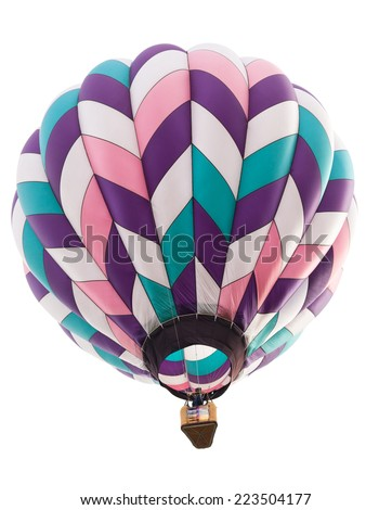 A hot air balloon in colors of pink, purple, green, and white floating above and isolated on white.