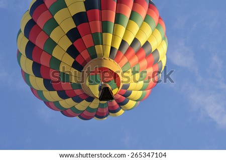 A hot air balloon in the sky a sunny day - stock photo