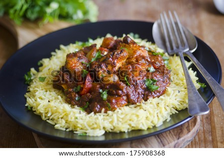 A hot and sour curry with char-grilled chicken, tomatoes and red chilies  - stock photo