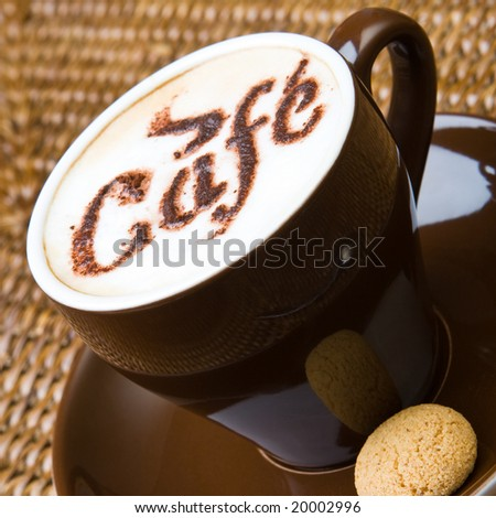 A hot cappuccino with an amaretti