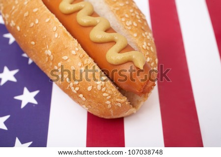 A hot dog on American flag - stock photo