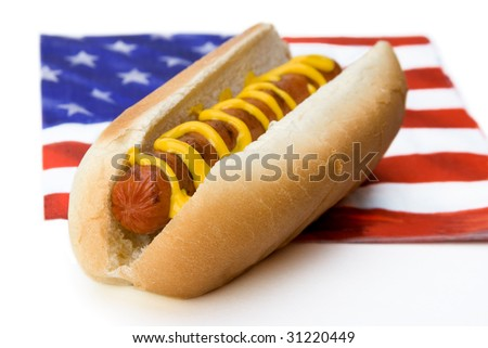 A hot dog sits on an American flag napkin. Great for Memorial Day or Fourth of July. - stock photo