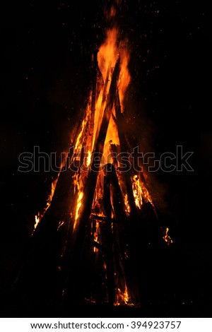 a hot romantic campfire at night
