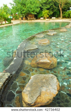 a hot spring on a pond - stock photo