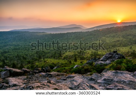 A hot summer sunset over the Grayson Highlands from Wilburn Ridge just off the Appalachian Trail - stock photo