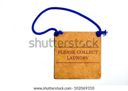A hotel door hanger for laundry made from recycled wood - stock photo