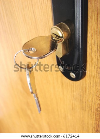 A hotel room door lock and key.