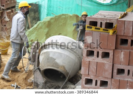 A house builder (bricklayer) at work.