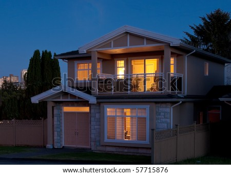 A house in suburbs at dusk in Vancouver, Canada. - stock photo