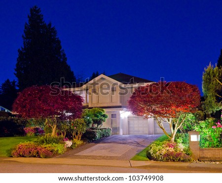 A house in suburbs at dusk ( night ) with nicely landscaped front yard in Vancouver, Canada - stock photo
