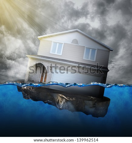 A house is sinking in water for a mortgage debt or natural disaster concept. - stock photo