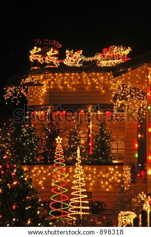A house lit to the max at X-mas. - stock photo