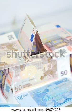 A house made from a selection of euro dollar bills. - stock photo