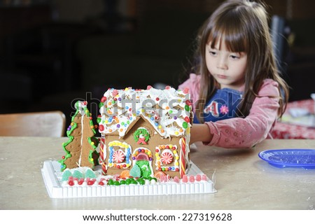 a house of ginger / a gingerbread house that is / focus on the house - stock photo
