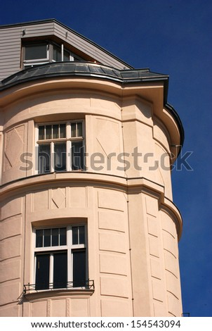 A house with a corner tower A house with a corner tower and a attic room.  - stock photo