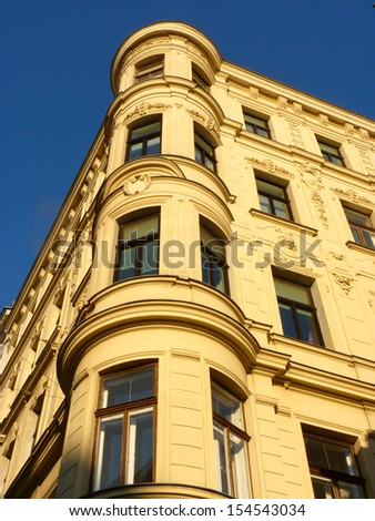 A house with a corner tower A house with a corner tower and stuccowork.  - stock photo
