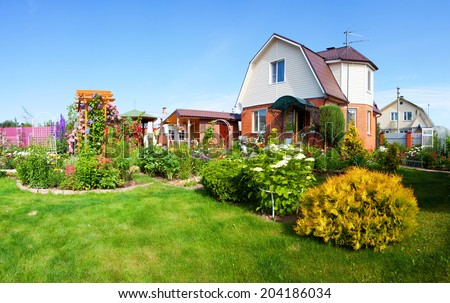 A house with a garden  - stock photo