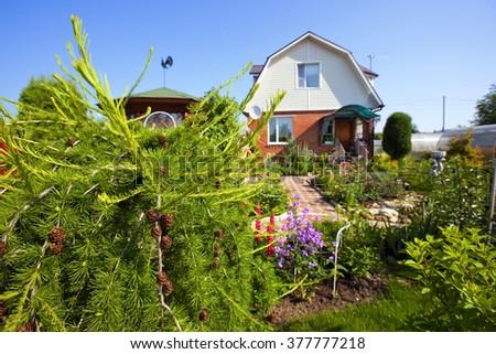A house with a garden - stock photo