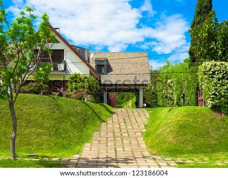 A house with green entrance in Colonia del Sacramento, Uruguay - stock photo