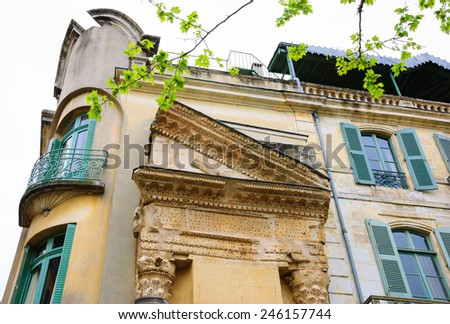 A house with Roman portico and columns in Arles (Provence, France).  - stock photo