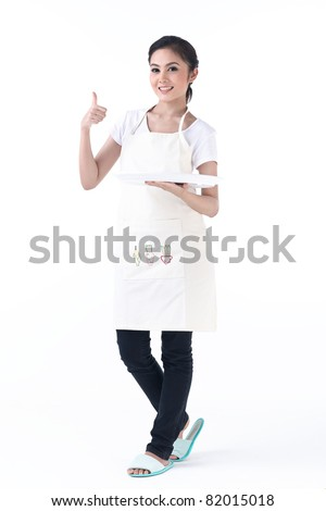 A housewife holding an empty tray , for you to put your product on it - stock photo