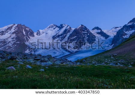 A huge Bartuy Glacier in the Caucasus Mountains, in the late evening - stock photo