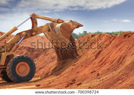 a huge bulldozer at Weipa bauxite mine