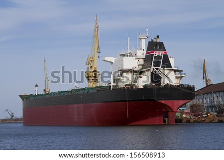 A huge cargo ship is being unloaded