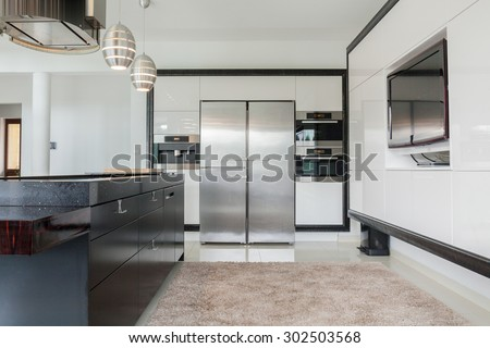 A huge classic kitchen in a modern residence - stock photo
