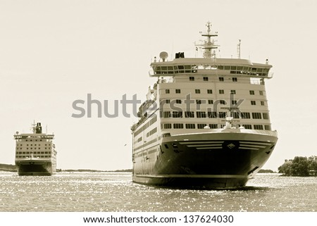 A huge ferries on the way from Mariehamn (Finland) to Stockholm (Sweden) - stylized retro - stock photo