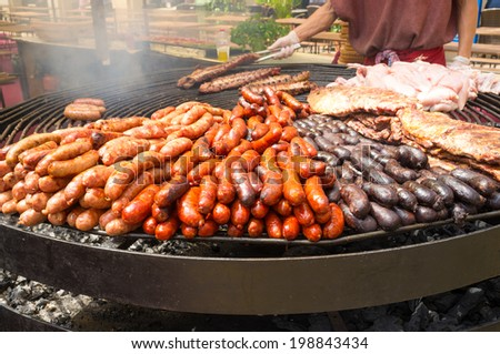 A huge grill loaded with assorted meat - stock photo