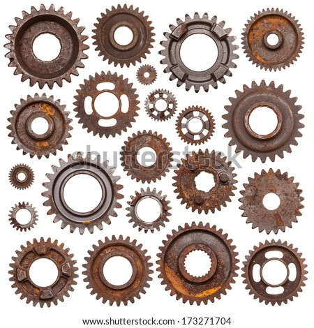 A huge set of rusty metal gears isolated on a white background. - stock photo