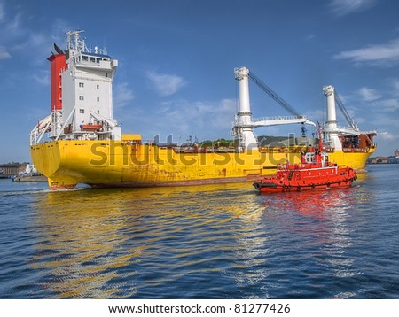 A huge ship heading for a port - stock photo