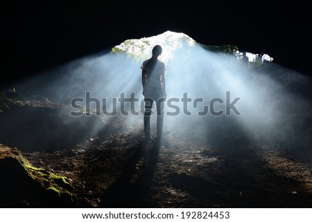 A human silhouette in a beam of light inside an abandoned mine in Banska Stiavnica.